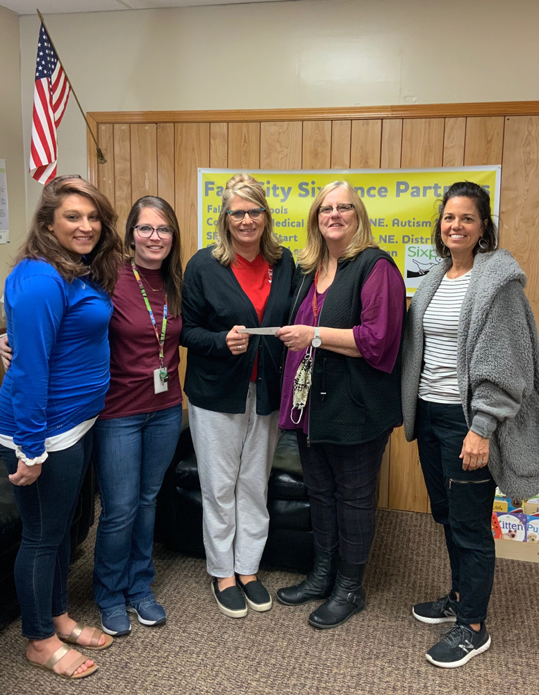 Sixpence Receives Donation from FCEA